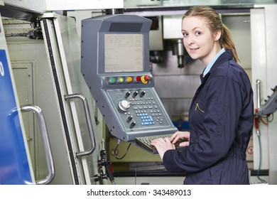 Female Apprentice Engineer Operating Computerized Cutting Machine