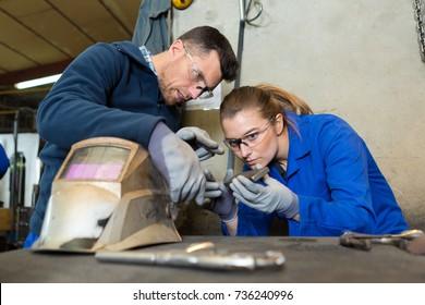 female apprentice welder