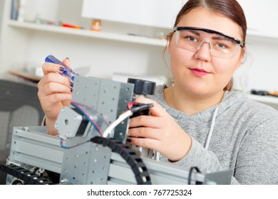 Female Apprentice working  on CNC machinery..