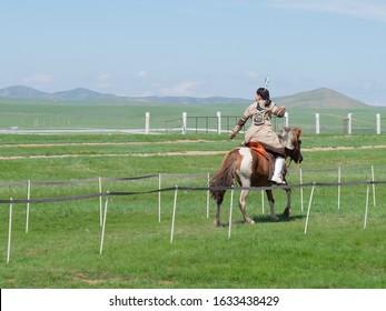 Female archer on horse at Nadaam festival near Ulanbataar, Central Mongolia (August 2018)