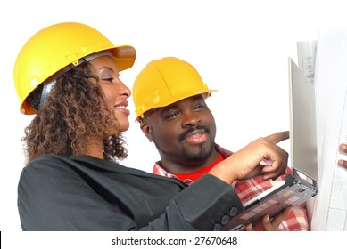Female architect and construction worker looking at laptop together