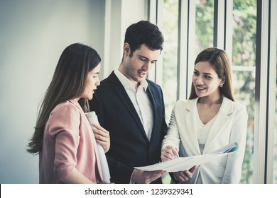 Female architect is showing her boss the real estate building plan