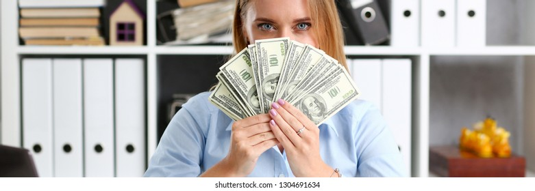 Female arm count hundred dollar bills closeup. Bribery accept backhander banknote venality laundering back scheme offshore company irs employee kickback collusion lobby gift compensation contribution