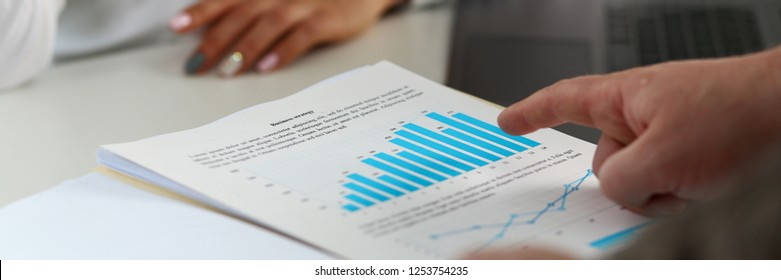 Female arm holding silver pen point in financial graph solving and discussing problem with colleague closeup. Situation examination at board council sale adviser job stock exchange market profit