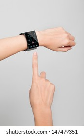 Female arm with a modern Internet Smart Watch on grey background. On the screen you can see a symbol for social networks. All Texts, Icons Interfaces of the Watch where created by myself.