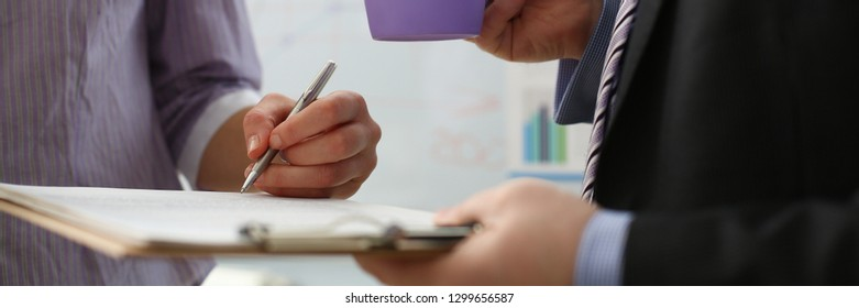 Female arm offer contract form on clipboard pad and silver pen to sign closeup. Strike bargain for profit white collar motivation union decision corporate executive sale insurance agent concept