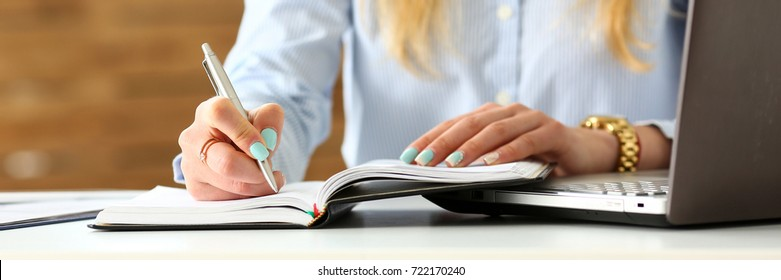 Female arm in suit hold silver pen making note in office pad closeup. Management training course, financial inspector job offer, fill survey form, project strategy, self development and perfection