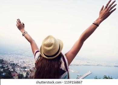Female arms raised on Alanya Turkey background