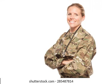 Female Army doctor or nurse in uniform on white background.  Female US Soldier in the medical field with arms crossed and copy space.
