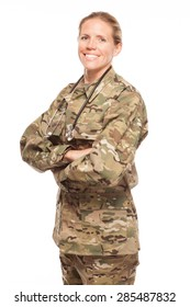 Female Army doctor or nurse in uniform on white background.  Female US Soldier in the medical field smiling.