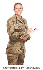 Female Army doctor or nurse in uniform on white background.  Female US Soldier in the medical field with pen and clipboard.