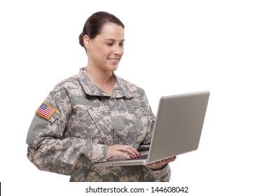 Female army soldier working on a laptop