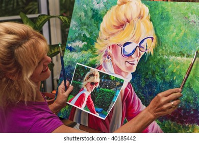 Female artist painting a self portrait