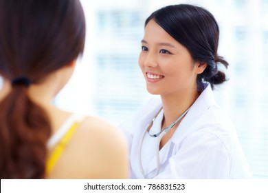 female asian doctor talking to patient