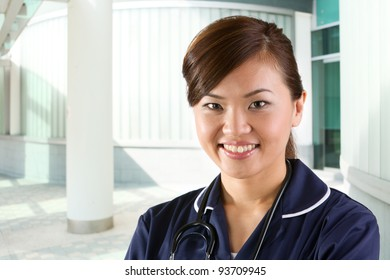 Female Asian Nurse with a stethoscope around her neck.