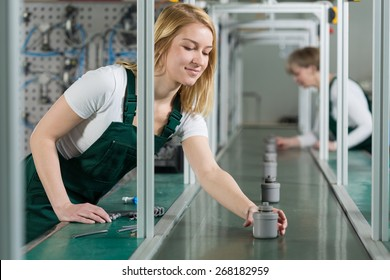 Female assembly line workers on production hall