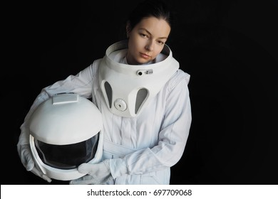 Female astronaut on a black background. Fantastic space suit. Exploration of outer space.