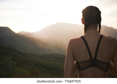Female Athelete Overlooking Sunset