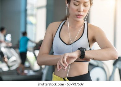 Female Athlete Checking Her Heart Rate on a Fitness Tracker