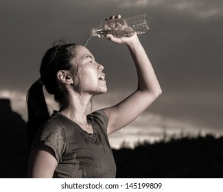 Female Athlete Cooling Off With Water