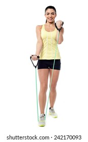 Female athlete doing exercises with resistance band