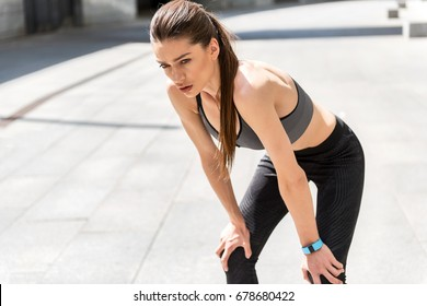 Female athlete is exhausted after jogging