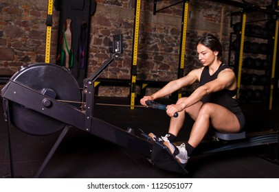 Female athlete on a rower