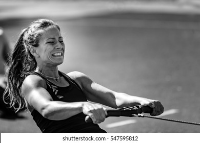 Female athlete on rowing machine on cross competition.