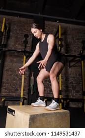 Female athlete practicing box jumps