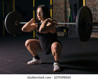 Female athlete practicing front squats