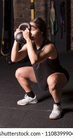 Female athlete practicing goblet squats