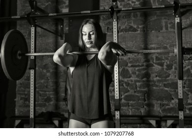 Female athlete practicing heavy lifts