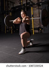 Female athlete practicing heavy lunges