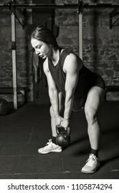 Female athlete practicing kettlebell drills