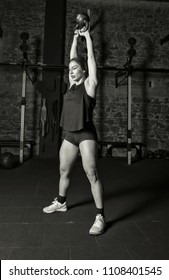 Female athlete practicing kettlebell swings