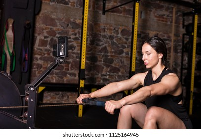 Female athlete practicing on a rower