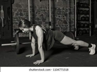 Female athlete practicing push ups and burpees