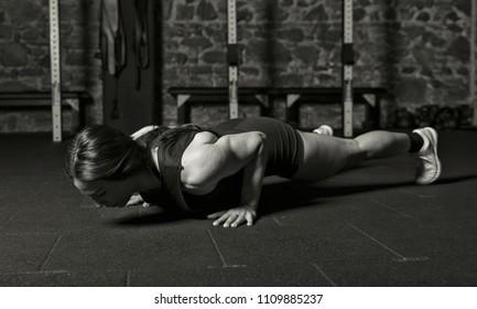 Female athlete practicing push ups