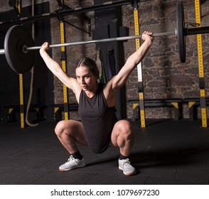 Female athlete practicing snatch movement