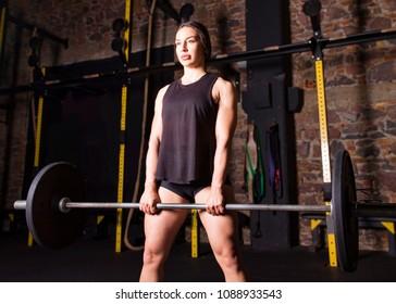 Female athlete practicing sumo deadlift