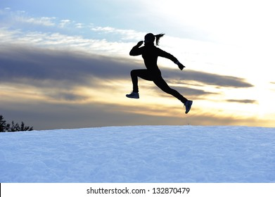 Female athlete running outdoors in winter