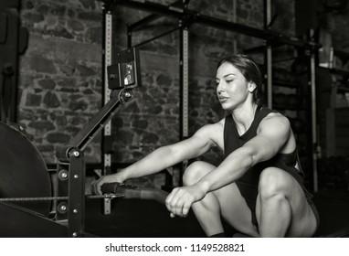 Female athlete doıing some rowing exercises