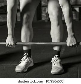 Female athlete starting a heavy lift
