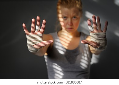 Female athlete stretching forward sweaty, dirty hands. Motivation of sports.