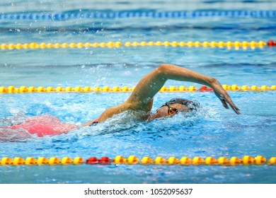 female athlete swimmer swim freestyle in pool competition