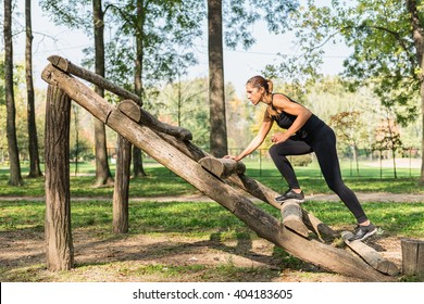 Female athlete training on obstacle course
