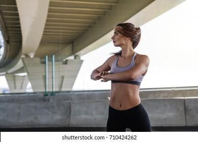 Female athlete warming up her body before training