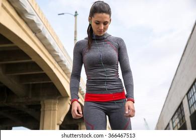 Female athlete women's sportswear fit thin physique athletic build outdoor city bridge portrait