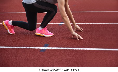 Female athletes  doing start runing in track  sport stadium with copy space