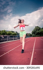 female athletic sportswoman on a track in the stadium